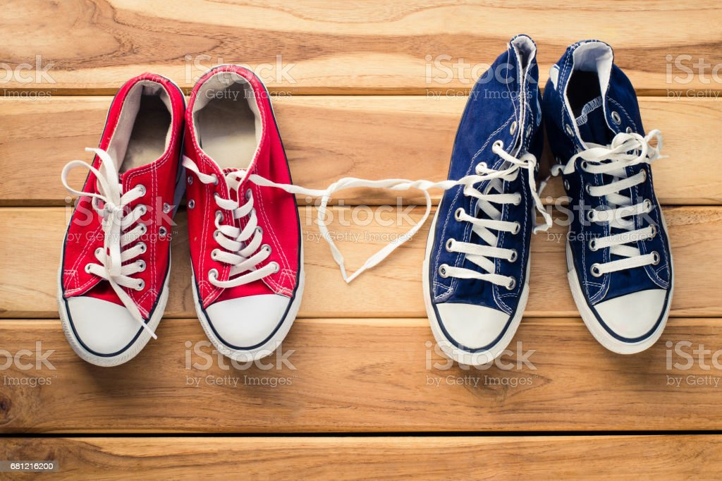 Two pairs of sneakers for men and women - the concept of love royalty-free stock photo
