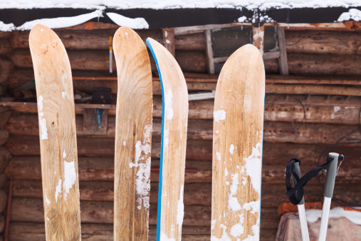two pairs of wide wooden hunting skis