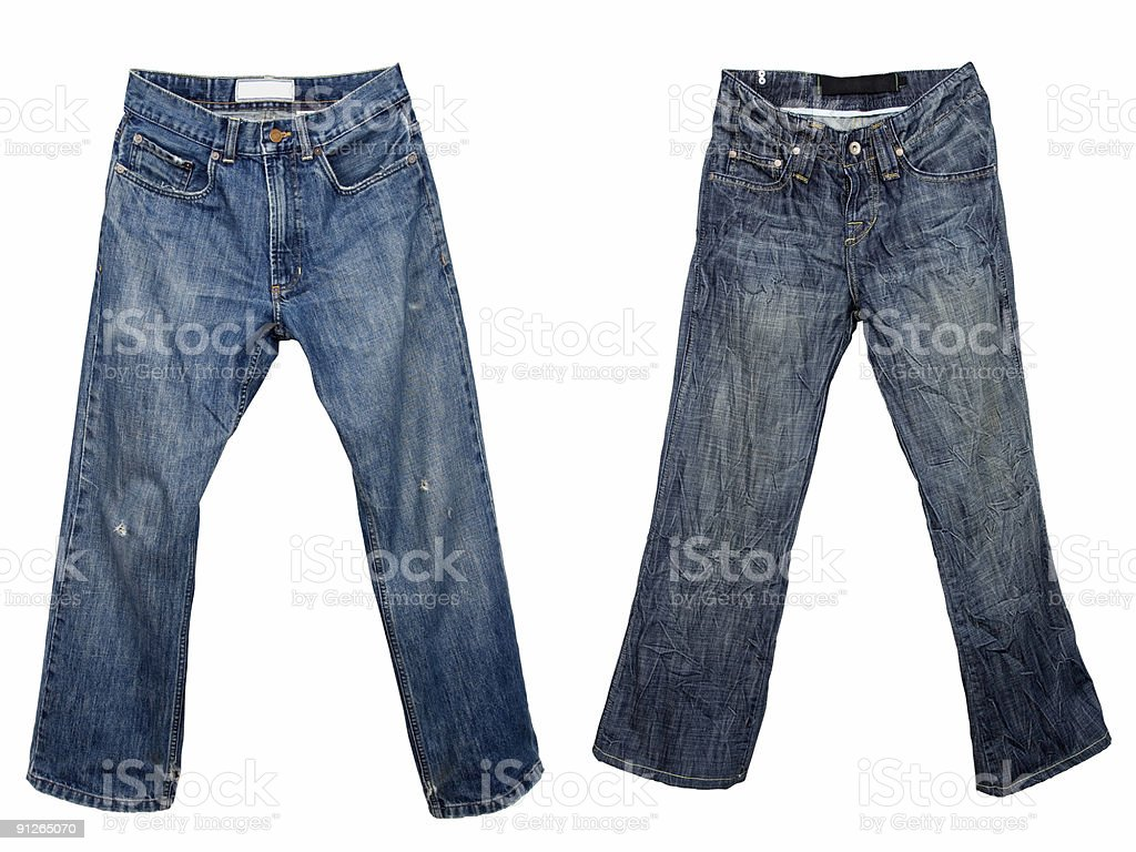 Two pairs of worn, raggedy blue jeans royalty-free stock photo