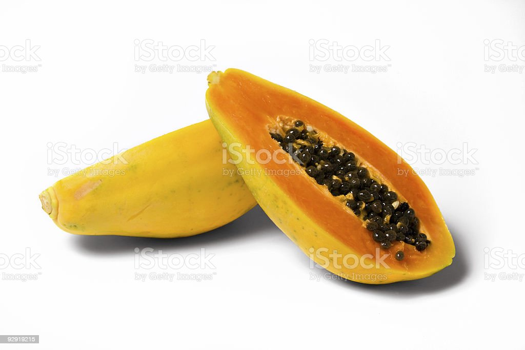 two papaya halves on white royalty-free stock photo