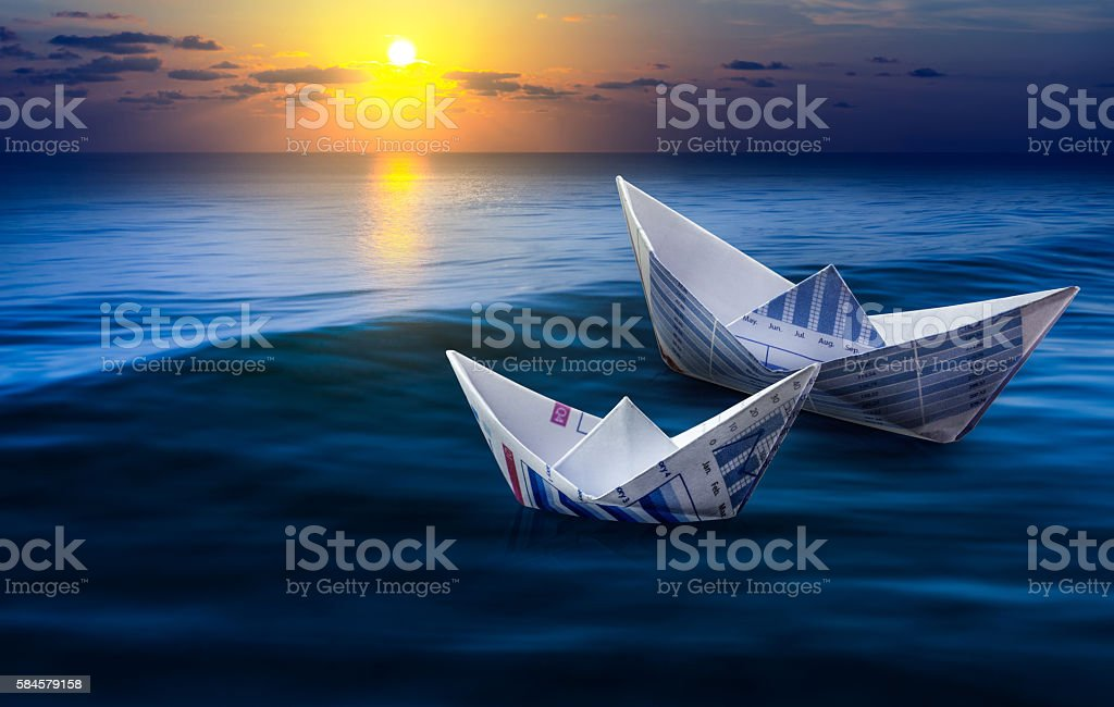 Two Paper Boats On Seabusiness Strong And Competition
