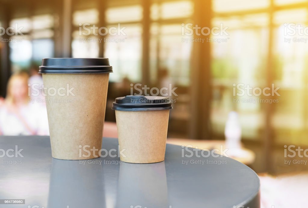 Two Paper cup of takeaway coffee on the table. Place for your text or logo. royalty-free stock photo