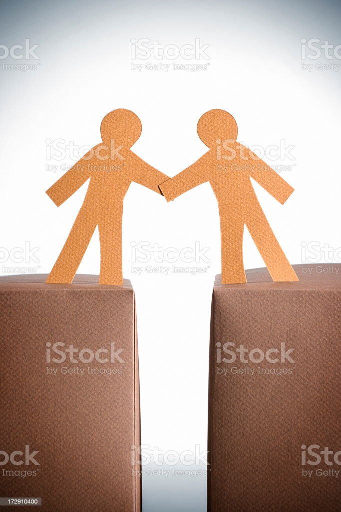 Two paper cut stick man figures shaking hands royalty-free stock photo