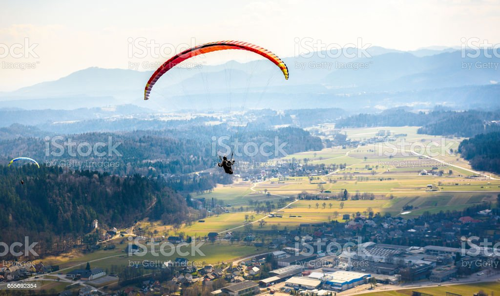 Two paragliders are flying in the valley. stock photo