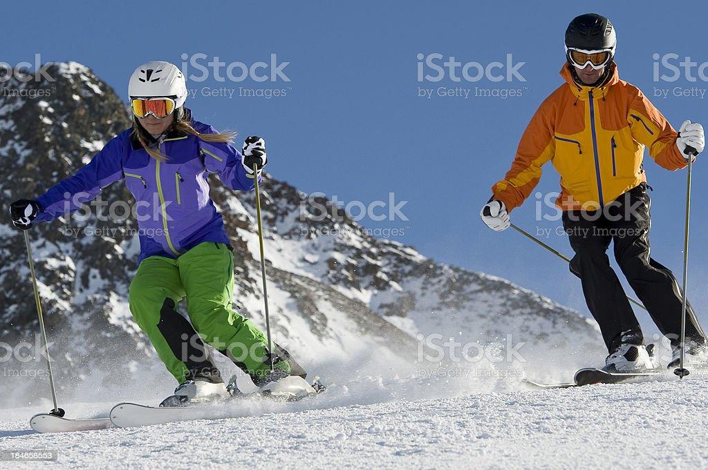 Two parallel slalom skiers stick stock photo