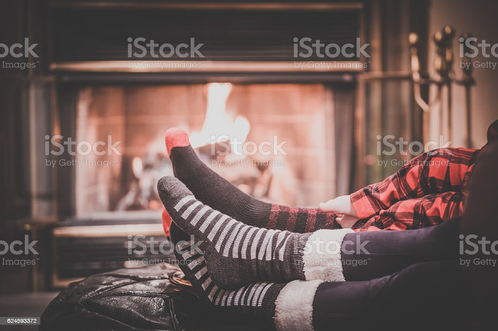 Two parents and baby feet Warming by Fireplace – Foto