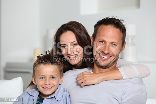 istock Two parents and their son sitting together 152110531