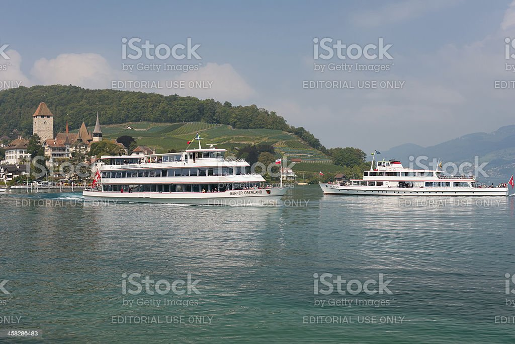 Two passenger ships at the harbor of Spiez. royalty-free stock photo
