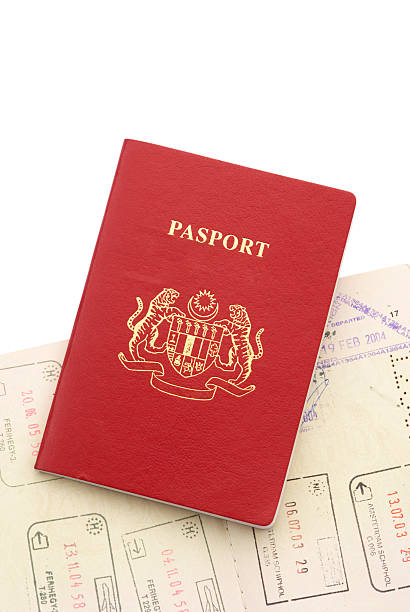 Two Passport stacking Isolated Two Passport Isolated on White Background and showing Immigration stamping pasport malaysia stock pictures, royalty-free photos & images