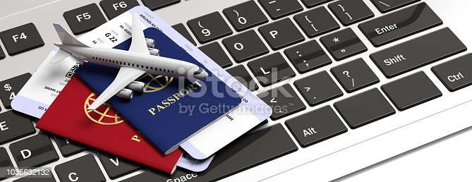 istock Two passports and airplane tickets on computer keyboard. 3d illustration 1035632132