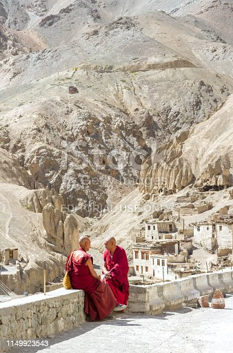 istock Two peaceful monks talk and rest during a break at the holy ceremony in the Buddhist monastery of Lamayuru 1149923543