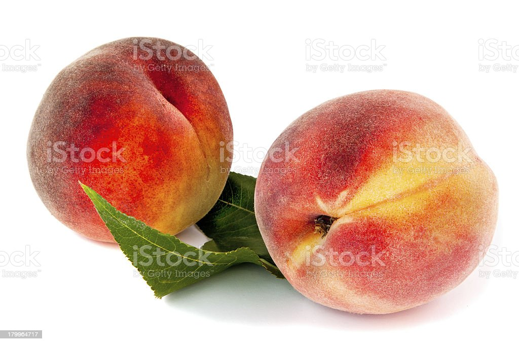 two peaches with leaves royalty-free stock photo