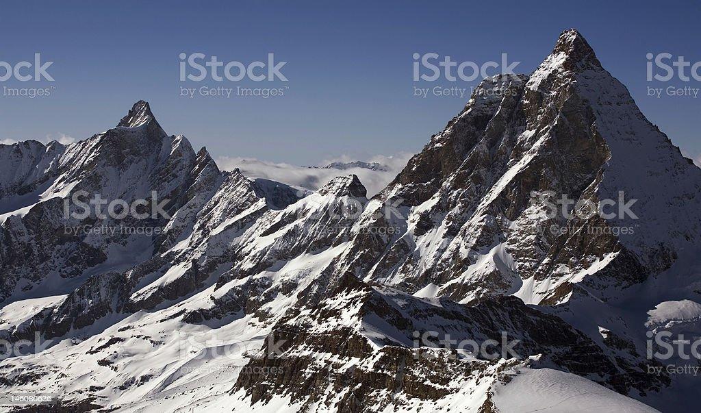 Two peaks in Alps. Bernese Oberland region royalty-free stock photo