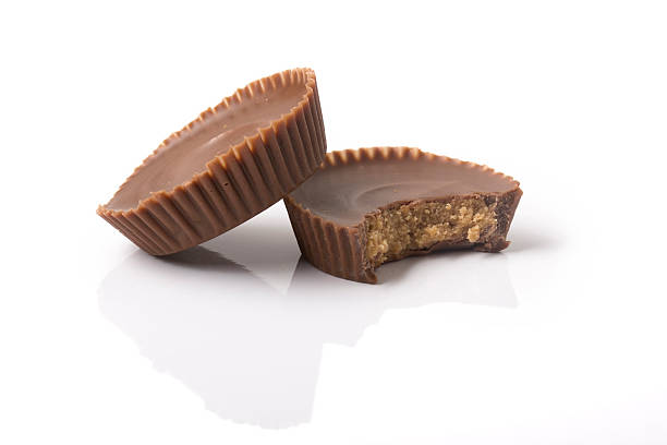 two peanut butter cups with bite - tazza foto e immagini stock