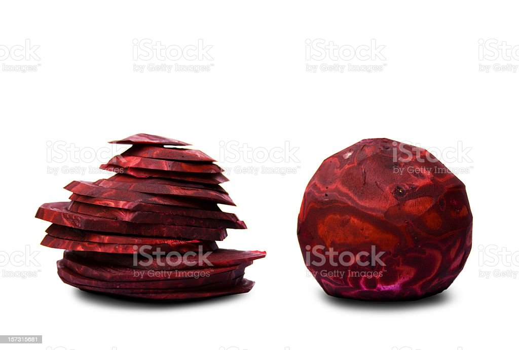 Two peeled and sliced red beets royalty-free stock photo