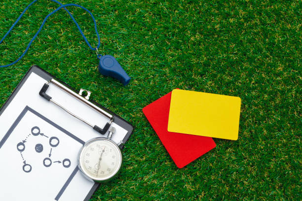 two penalty cards and a whistle for the referee - judge sports official stock photos and pictures