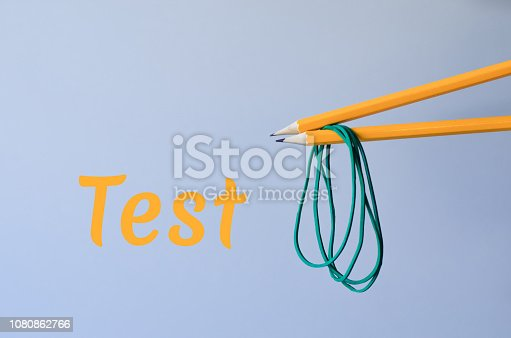 istock Two pencils with rubber bands. 1080862766