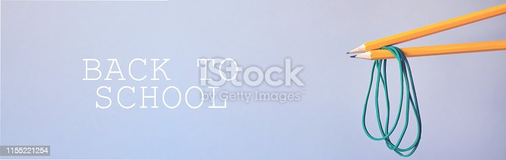 istock Two pencils with rubber bands. 1155221254