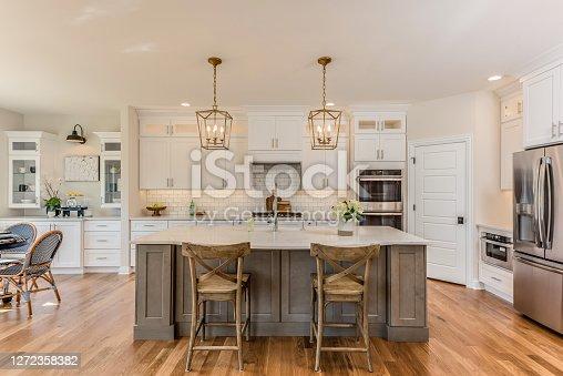istock Two pendant lights hang over kitchen island 1272358382