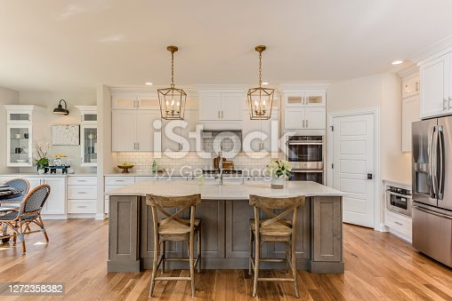 New hardwood flooring in kitchen with new bottom freezer refrigerator
