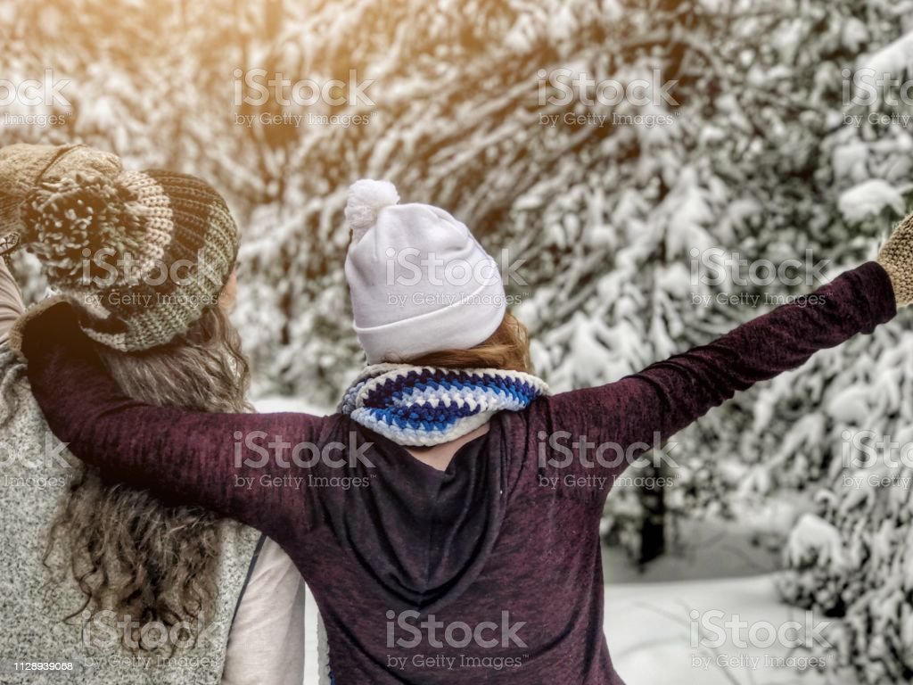Two people, a grandmother and older grandchild, a girl, having an...