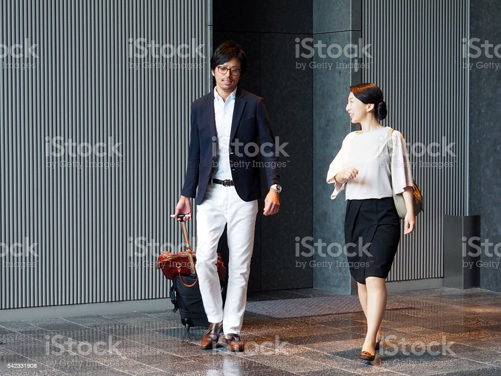 people talking in elevator. two people are walking, elevator hall royalty-free stock photo talking in