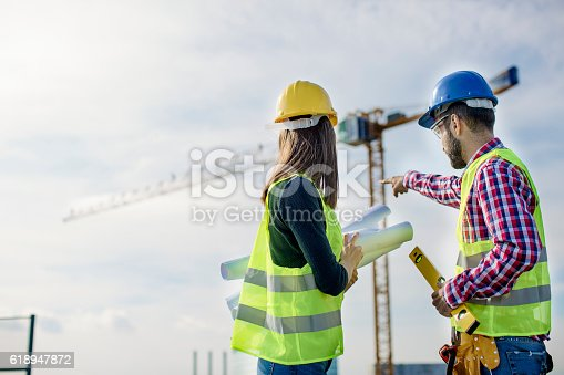 617878058 istock photo Two people at construction site 618947872