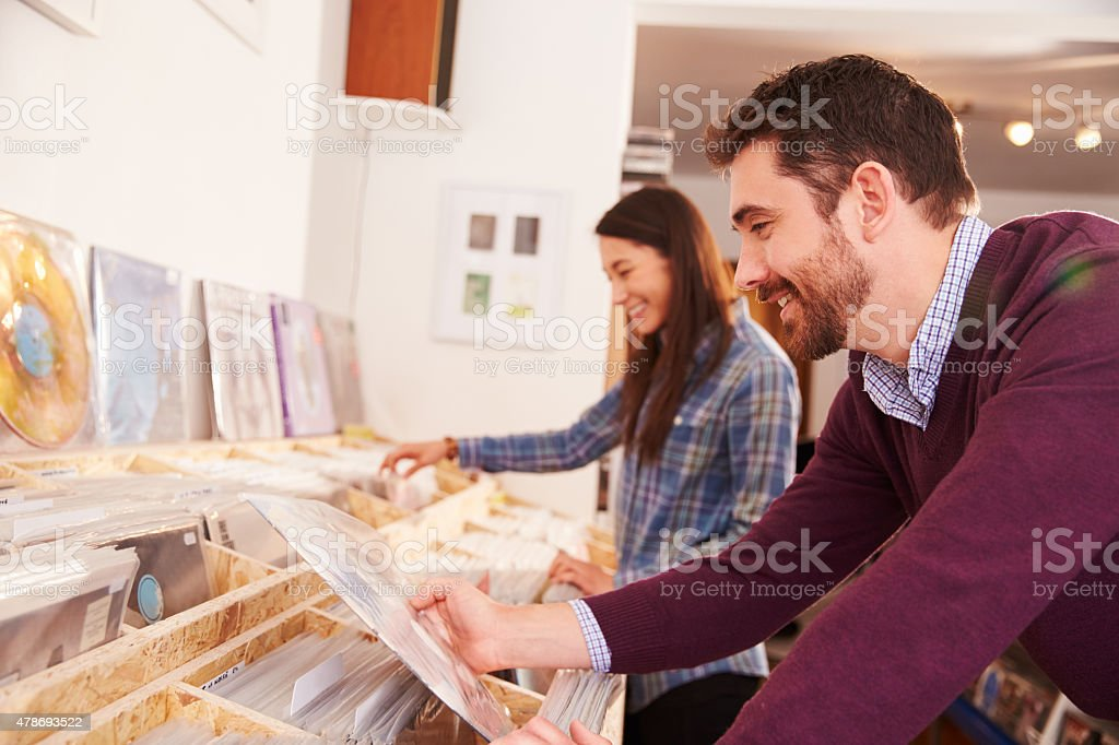 Two people browsing through records at a record shop stock photo