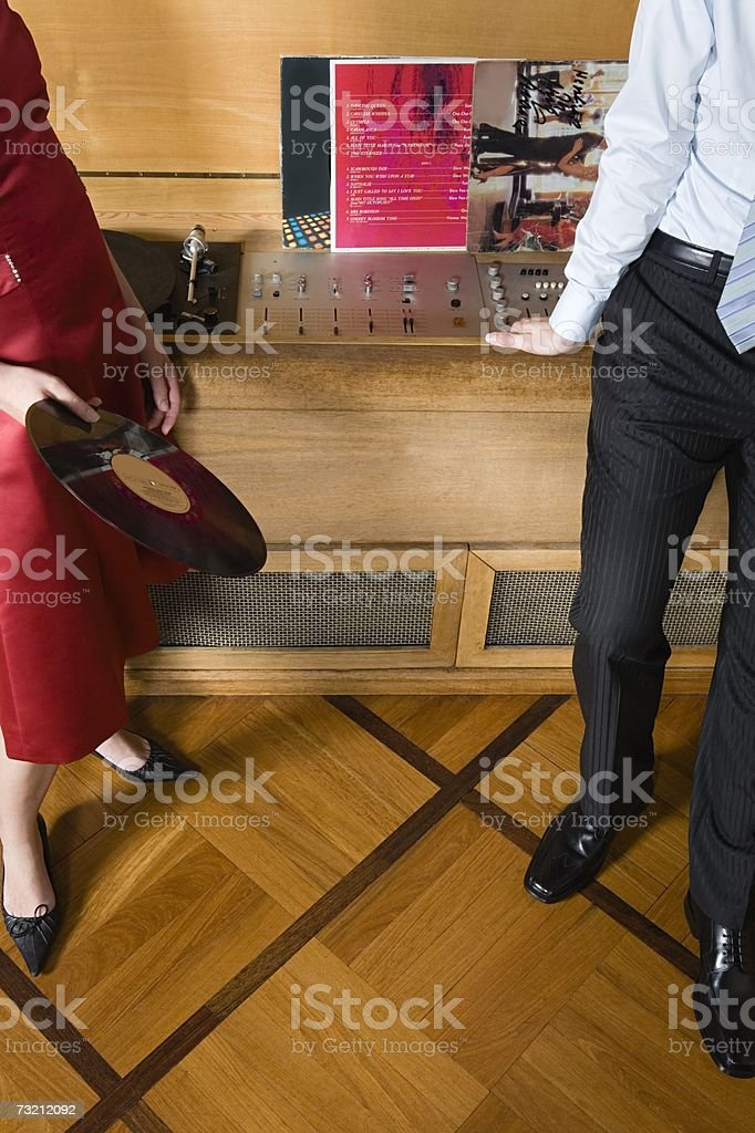 Two people by a retro turntable stock photo