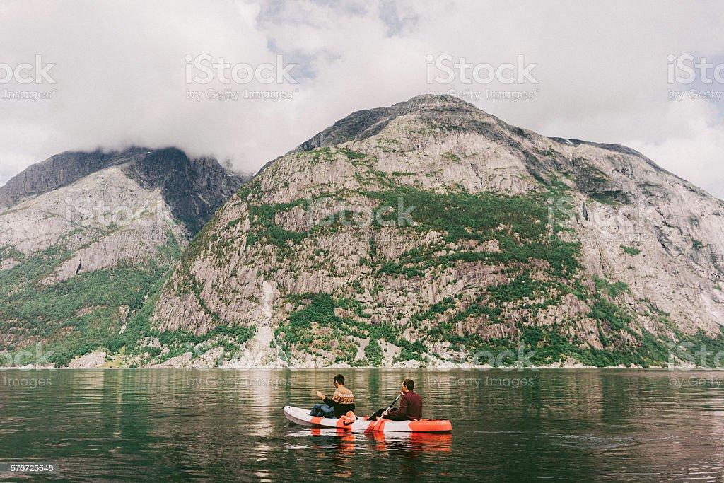 Two people canoeing in Eidfjord, Norway