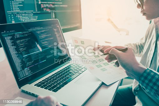 istock Two people coding code program programming developer computer web development coder working design software on desk in office. 1130269946
