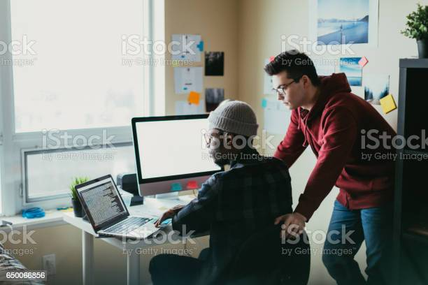 Two people collaborating around a computer picture id650066856?b=1&k=6&m=650066856&s=612x612&h= ln qulp ebbp0plt3ipuytihyyugb lxikgwvbopxm=