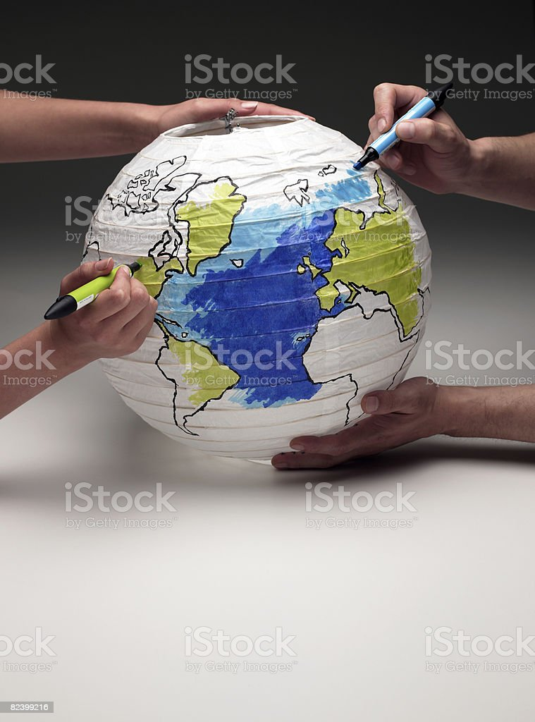 two people coloring in a globe lamp royalty-free stock photo