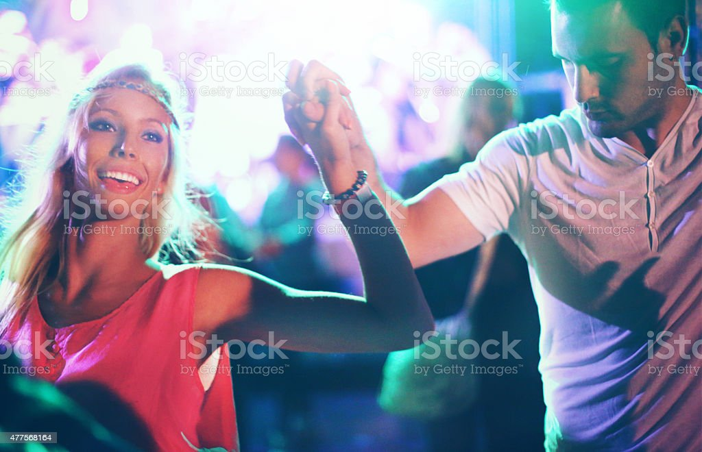 Two people dancing at concert. stock photo