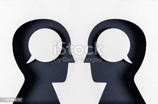 two people discussing face to face