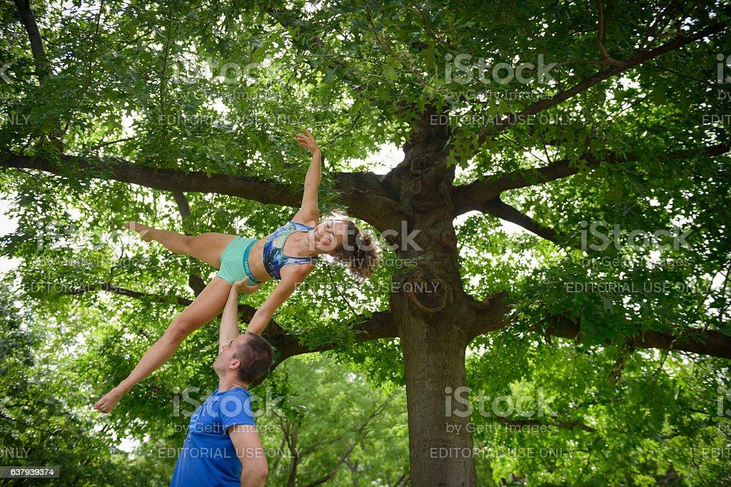 Two people doing acroyoga in Washington DC stock photo