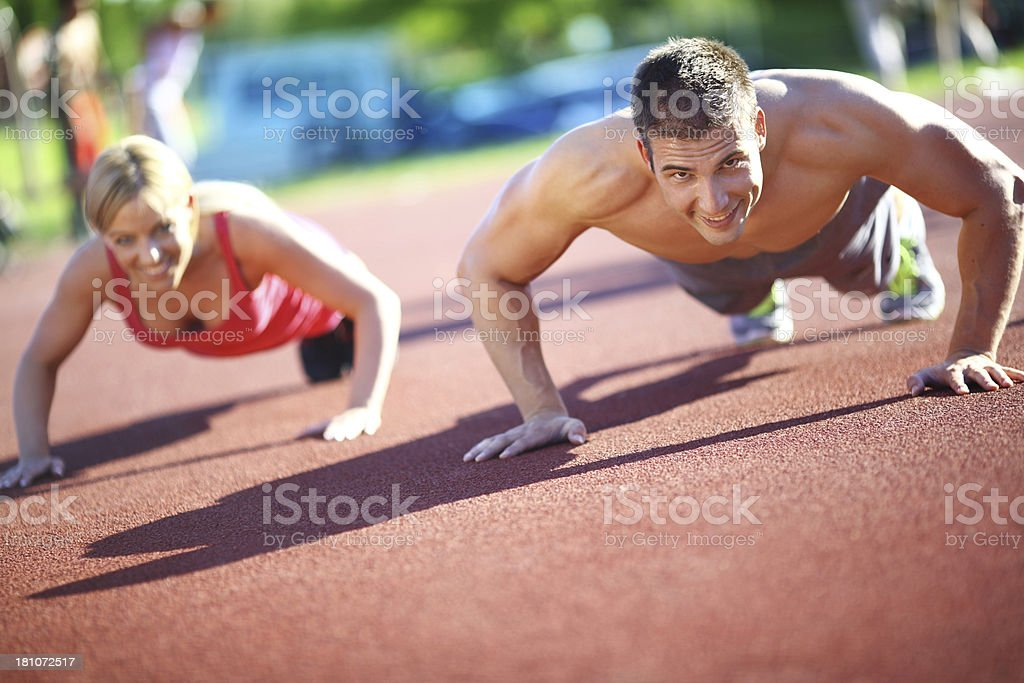 Two people doing push-ups. royalty-free stock photo