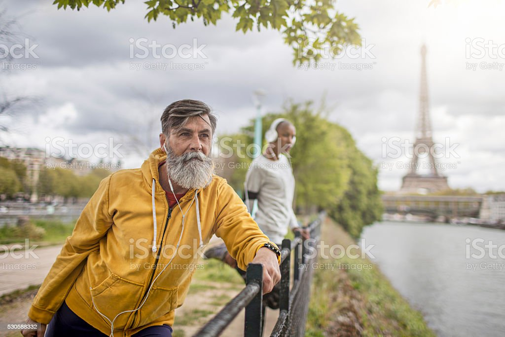 Two people doing sport in the morning at Paris stock photo