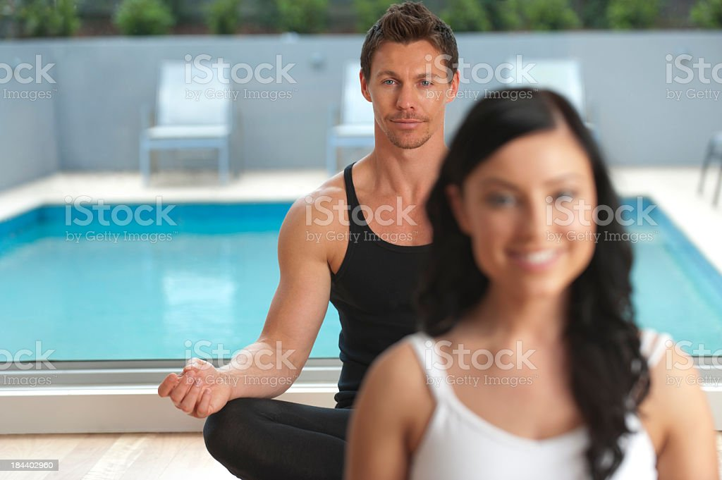 Two people doing yoga at a health club royalty-free stock photo