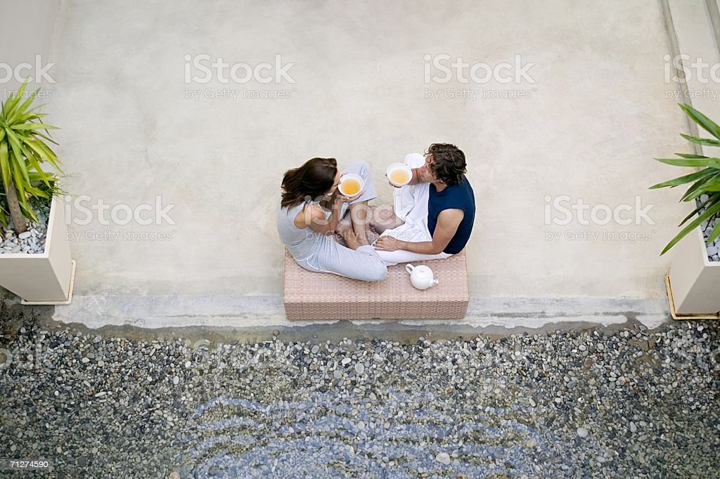 Two people drinking tea stock photo