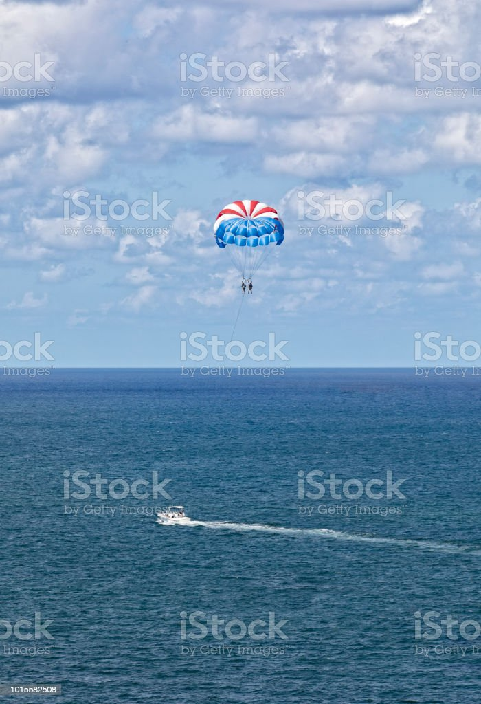 Two people go parasailing on the Atlantic Ocean stock photo
