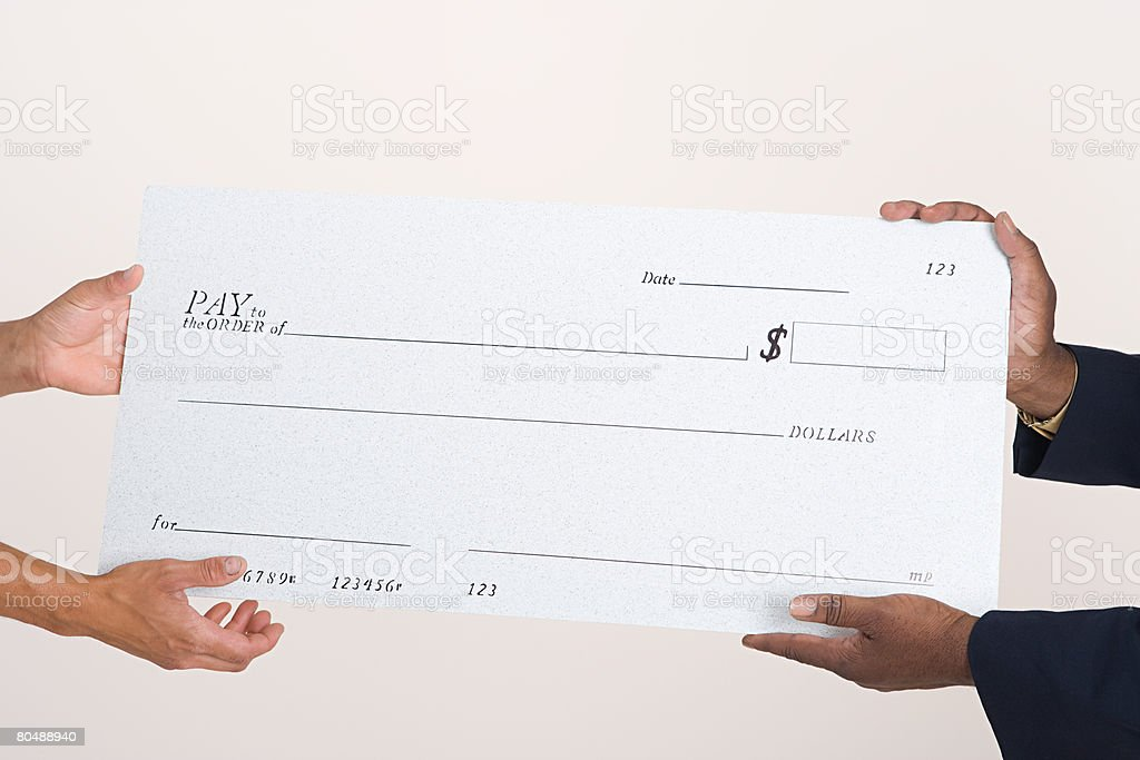 Two people holding a cheque stock photo