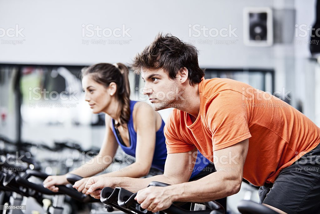 Two people in a cycling class stock photo