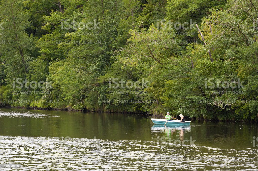 """Two people in a rowing boat on the river """"Saale"""" royalty-free stock photo"""