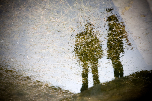 Two People In Reflection Stock Photo - Download Image Now