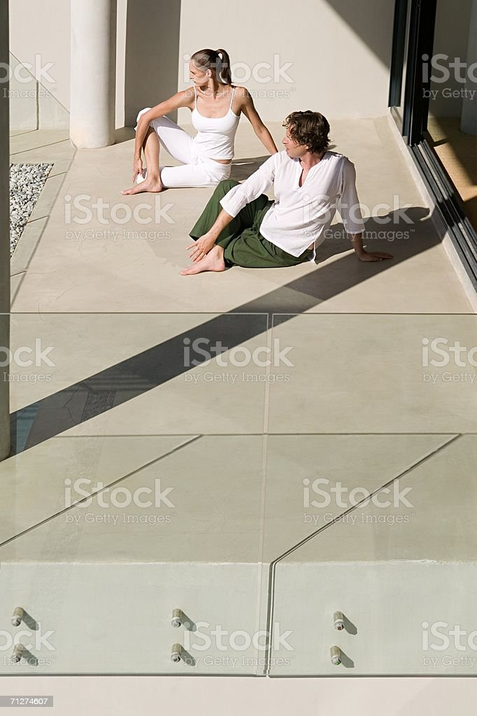 Two people in yoga positions royalty-free stock photo