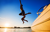 istock Two people jumping in water against the blue sky. 175528605