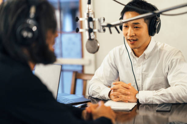 Two people making talkshow for radio Two men are making a talkshow in a radio station. radio dj stock pictures, royalty-free photos & images