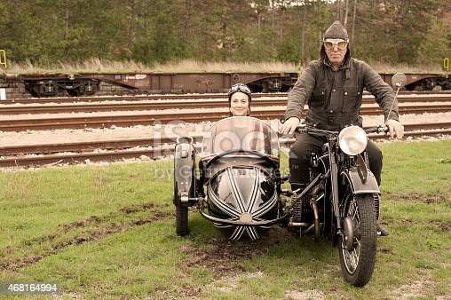 Road trip with a vintage motorcycle and sidecar.