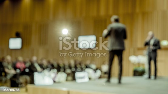 938409136 istock photo Two people on stage at a speaking event 938255736